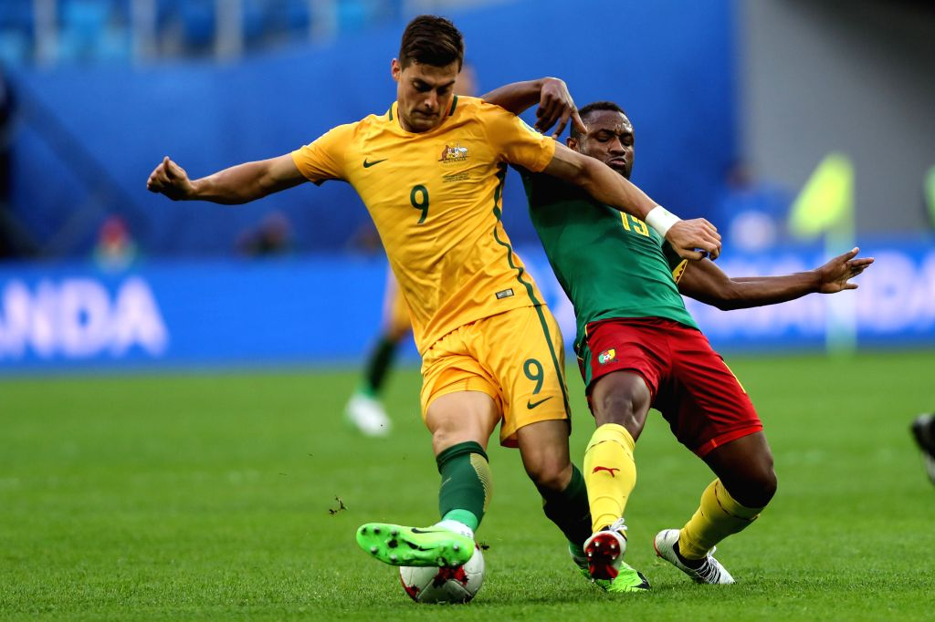 ST.Sebastien Siani(R) of Cameroon vies with Tomi Juric of Australia during the group B match between Cameroon and Australia at the 2017 FIFA Confederations Cup ...