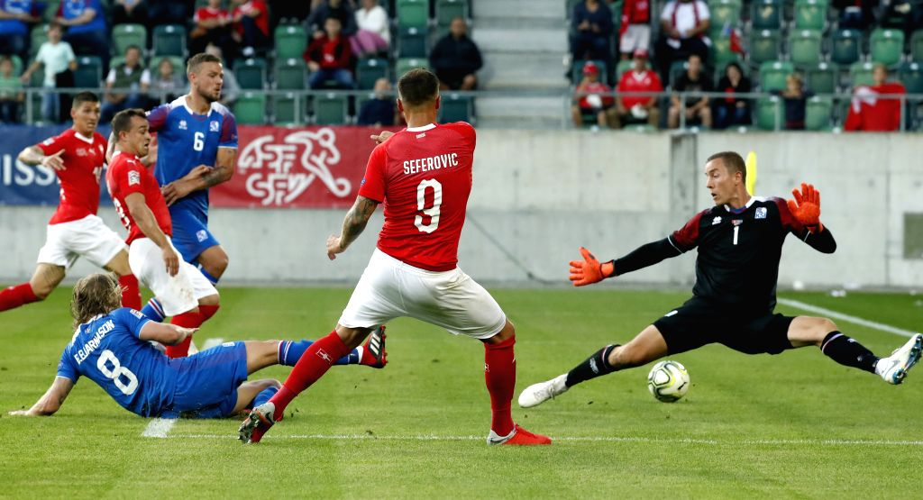 ST.Switzerland's Haris Seferovic (2nd R) scores a goal against Iceland's goalkeeper Hannes Halldorsson during the UEFA Nations League group A2 match between ...