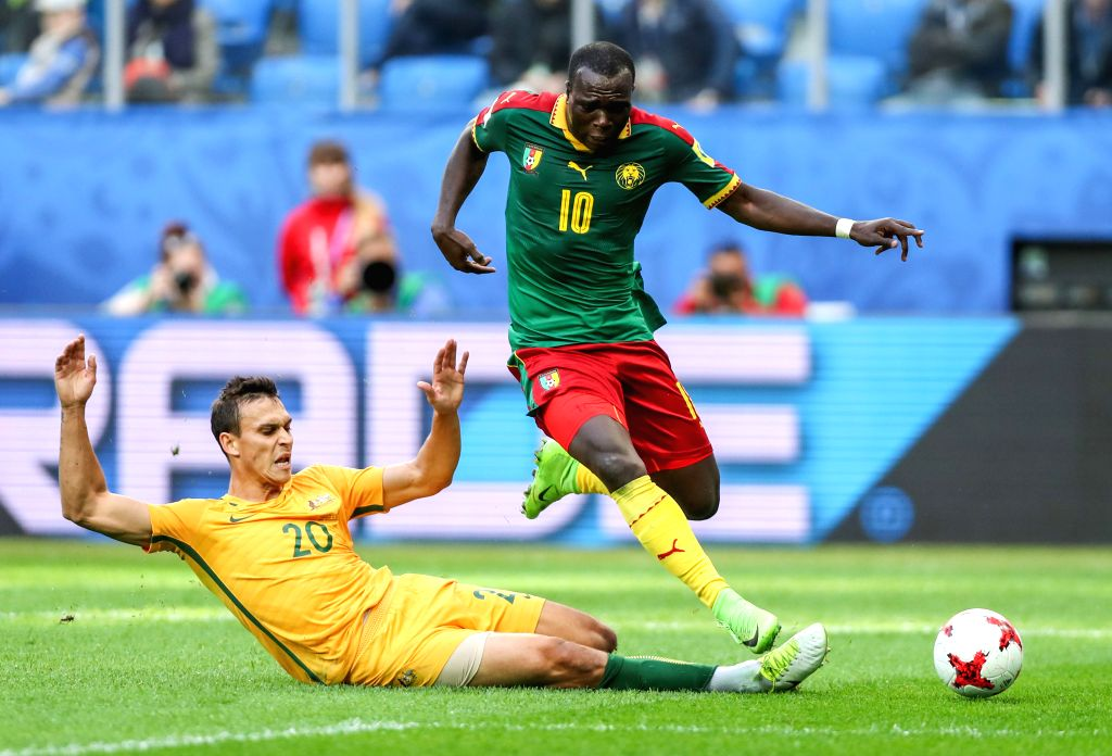 ST.Vincent Aboubakar (R) of Cameroon vies with Trent Sainsbury of Australia during the group B match between Cameroon and Australia at the 2017 FIFA ...