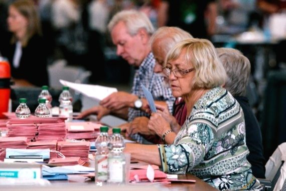 Staff members count votes for Germany's federal elections in Cologne, Germany, Sept. 26, 2021.