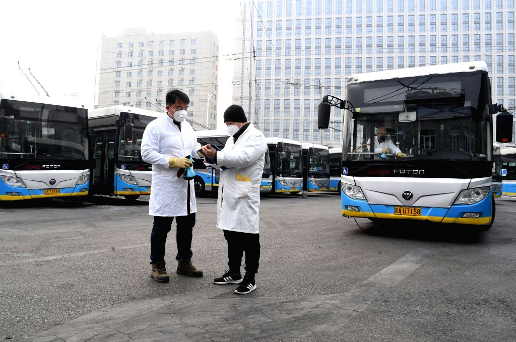 Staff members record the disinfecting log at a bus station in Beijing, capital of China, Jan. 27, 2020. Beijing Public Transport Corporation has taken measures such ...