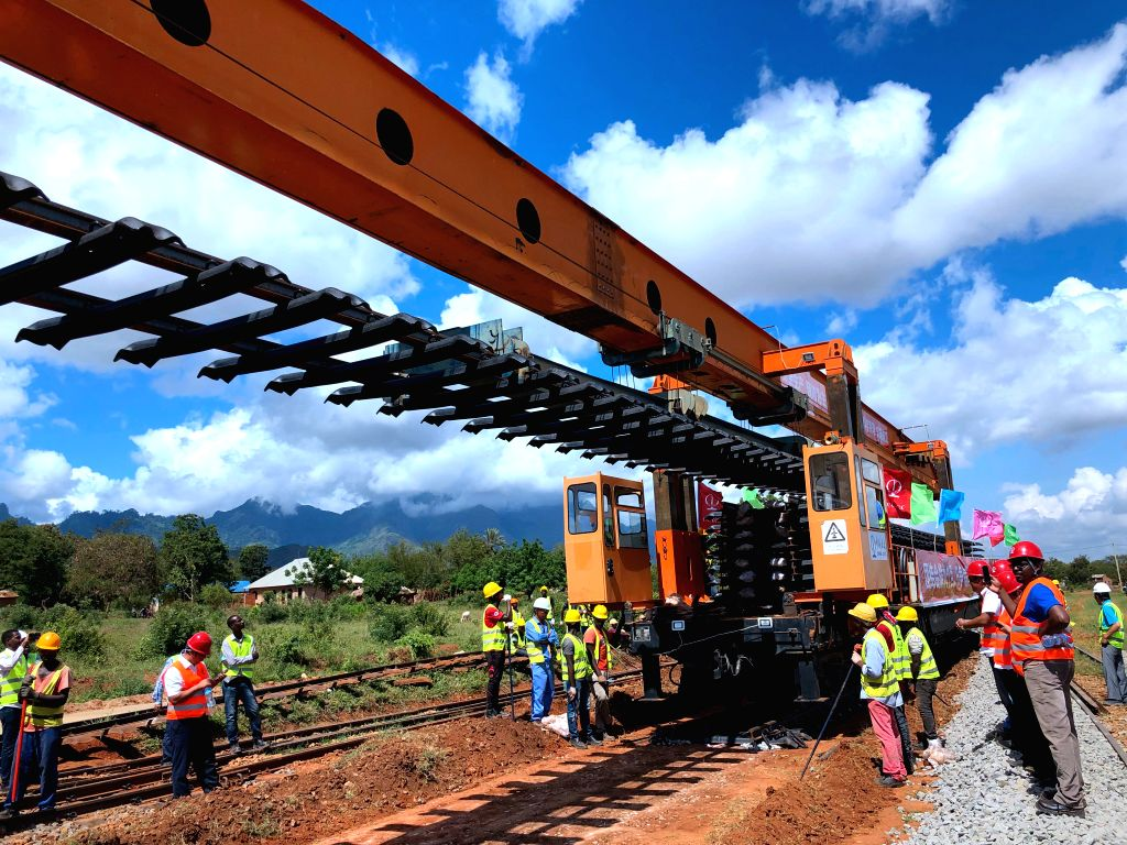 Staff members work at a site of Tanzania's Central Railway Line rehabilitation project undertaken by China Civil Engineering Construction Corporation in ...
