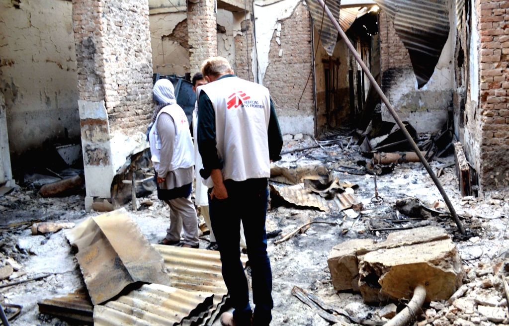 Staff of the Medecins Sans Frontieres (MSF) hospital investigate the building after a U.S. airstrike in Kunduz city, capital of northern Kunduz province of ...
