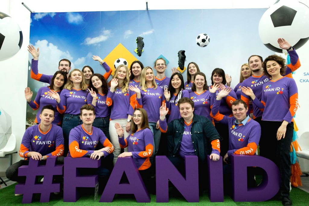 Staff pose for photograph at a newly-opened fan ID center of the UEFA Euro 2020 soccer tournament finals in Saint Petersburg, Moscow, Dec. 4, 2019. Saint ...