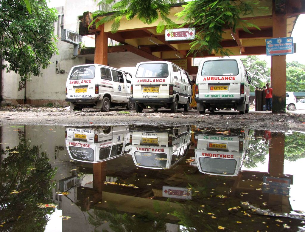 Stagnant water at the parking lot of North Bengal Medical College in Siliguri which acts as the breeding grounds for mosquitoes. Sept. 25, 2013. (Photo: IANS)