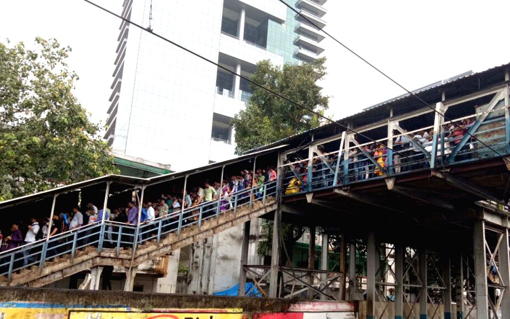 Stampede breaks out at on a narrow railway footover bridge connecting the Parel-Elphinstone Road stations of Western Railway in Mumbai on Sept 29, 2017. At least 22 commuters were killed.
