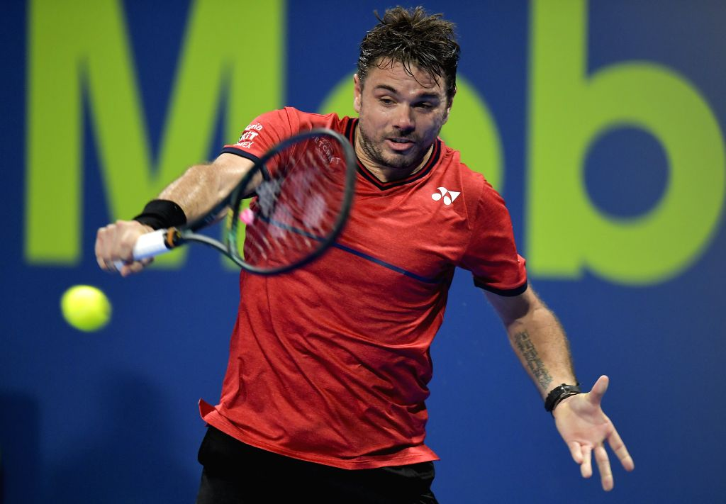 Stan Wawrinka of Switzerland returns the ball during the singles semifinal match against Corentin Moutet of France at ATP Qatar Open tennis tournament in Doha, Qatar, ...