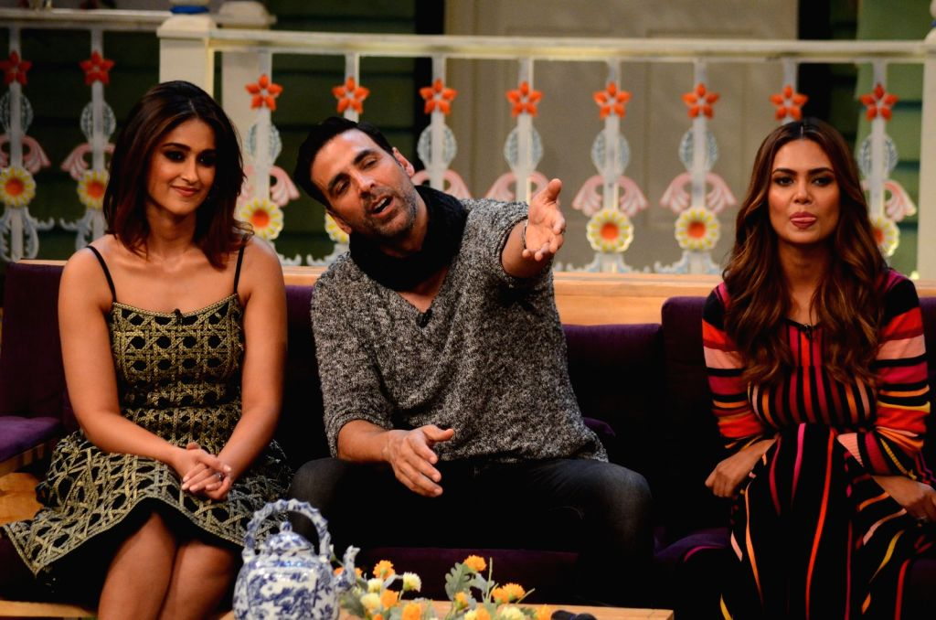 Stand-up comedian Kapil Sharma with actors Ileana D'Cruz and Esha Gupta during the promotion of film Rustom on the sets of The Kapil Sharma Show in Mumbai, India on August 5, 2016. - Ileana D'Cruz, Kapil Sharma and Esha Gupta