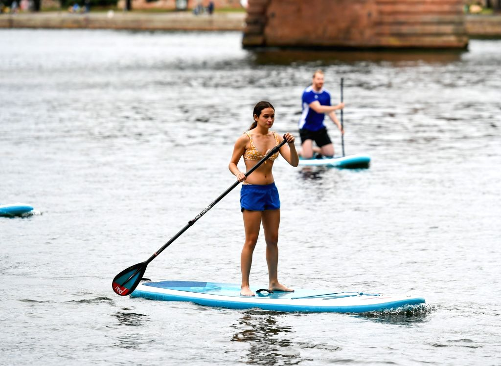 Standup paddle boarding enthusiasts exercise on the Main in Frankfurt, Germany, on Aug. 29, 2020.