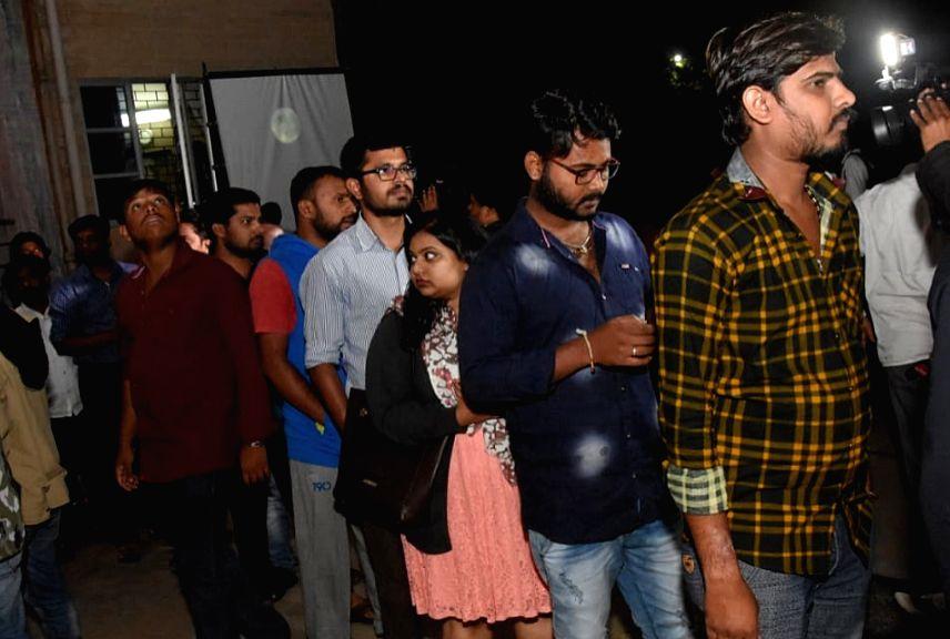 Stargazers arrive at Jawaharlal Nehru Planetarium to observe lunar eclipse in Bengaluru on July 27,  2018.