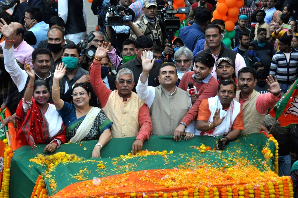 State BJP President Dilip Ghosh, State BJP vice President Bharati Ghosh, Union minister of State Debosree Chowdhury, BJP leader Suvendu Adhikary with party activists during a roadshow in ... - Dilip Ghosh and Bharati Ghosh