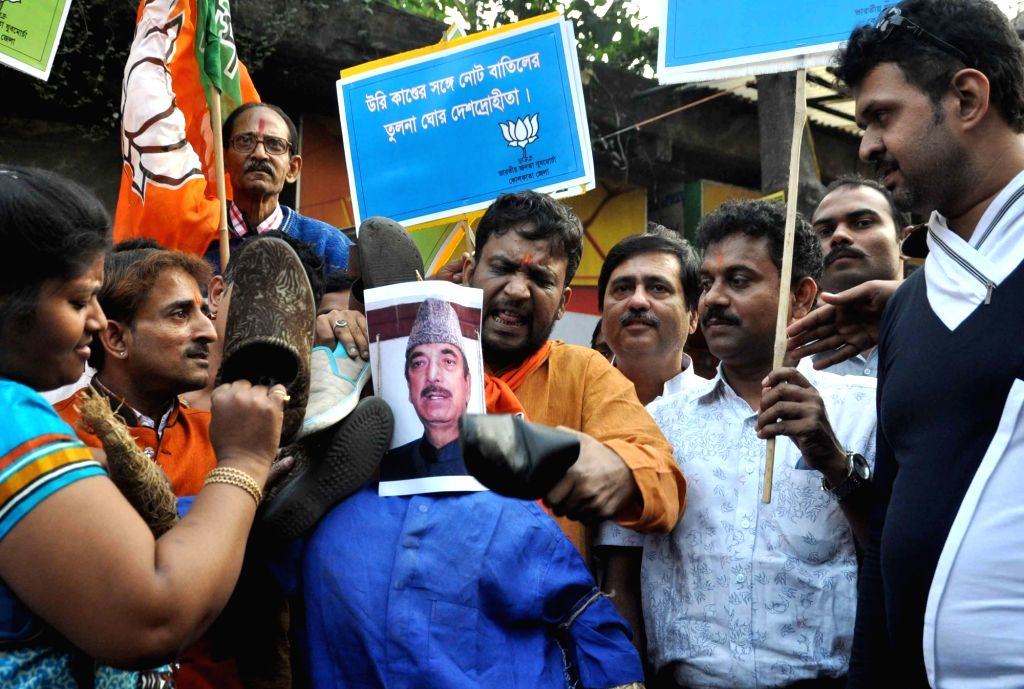 State BJP Yuva Morcha activists protest against the statement Congress leader Gulam Nabi Azad in Kolkata on Nov 19, 2016.