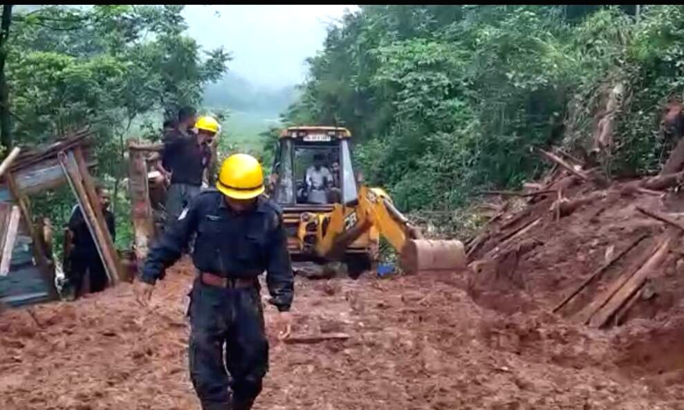 State Disaster Rescue Force (SDRF) carry out rescue operations after landslide caused by incessant rains in Tharia village, Meghalaya on June 17, 2017.