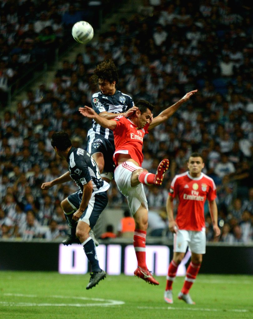 Stefan Medina (top) of Monterrey competes in the friendly match against Portugal's Benfica at the BBVA Bancomer Stadium in Guadalupe Municipality, Mexico, on Aug. ...