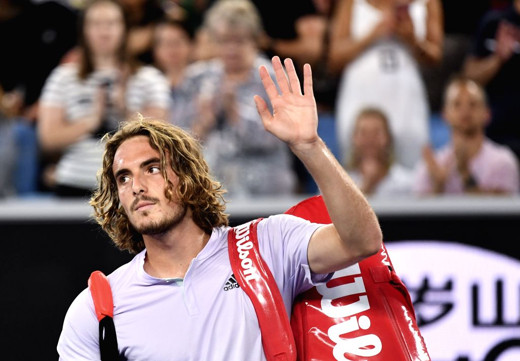 Stefanos Tsitsipas of Greece waves to spectators after the men's singles third round match against Milos Raonic of Canada at the 2020 Australian Open tennis ...