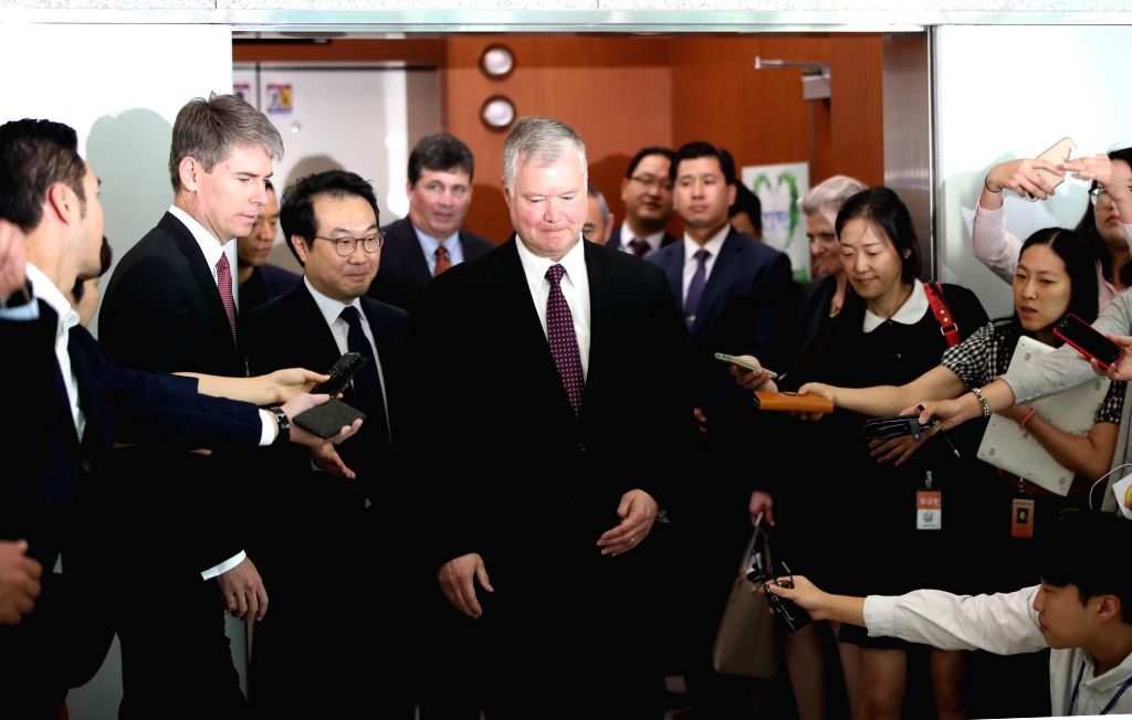 Stephen Biegun (C) leaves after brief remarks to the press following his talks with South Korea's top nuclear envoy Lee Do-hoon (to Biegun's right) at the foreign ministry in Seoul on Sept. ...
