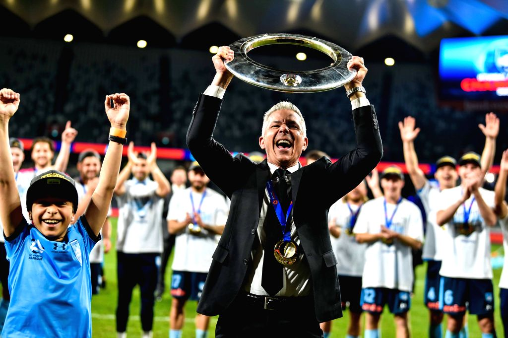 Steve Corica (Front), manager of Sydney FC, celebrates during the awarding ceremony for the 2019/2020 season A-League in Sydney, Australia, Aug. 30, 2020. Sydney FC ...