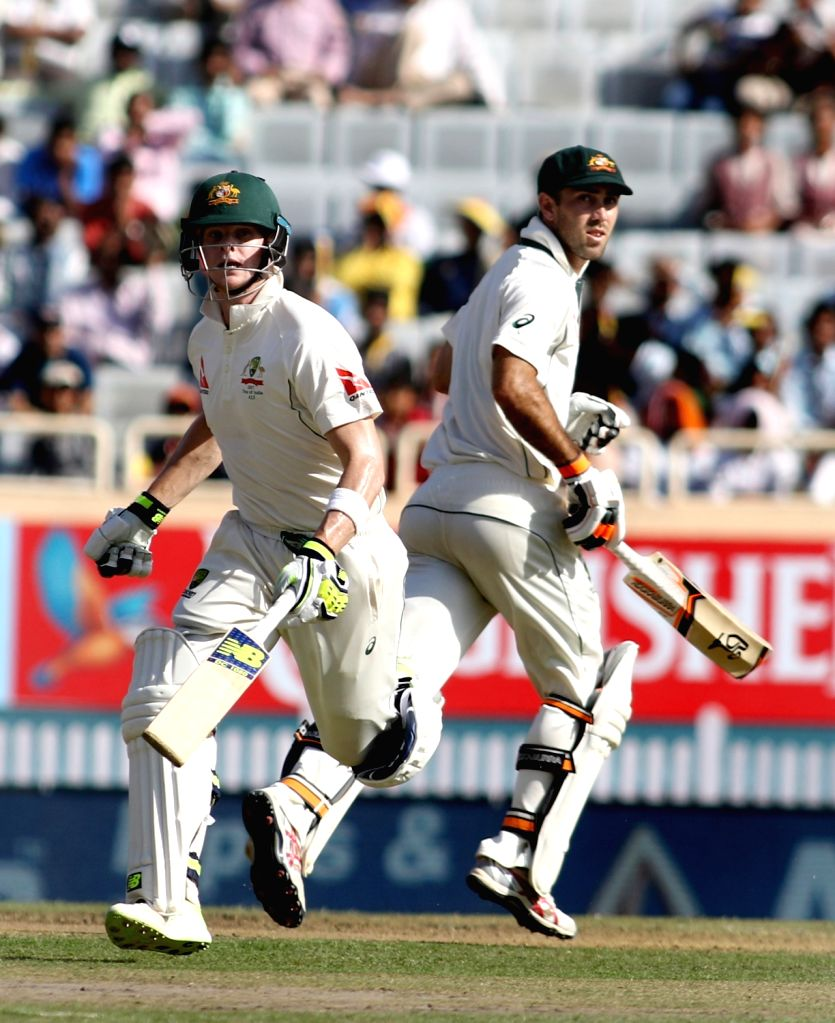 Steve Smith and Glenn Maxwell of Australia in action during the first day of the third cricket test match between India and Australia at the Jharkhand State Cricket Association (JSCA) Stadium ...