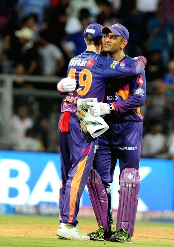 Steven Smith and MS Dhoni of Rising Pune Supergiant celebrate after winning the first qualifier of IPL 2017 between Mumbai Indians and Rising Pune Supergiant at Wankhede Stadium in Mumbai on ... - MS Dhoni