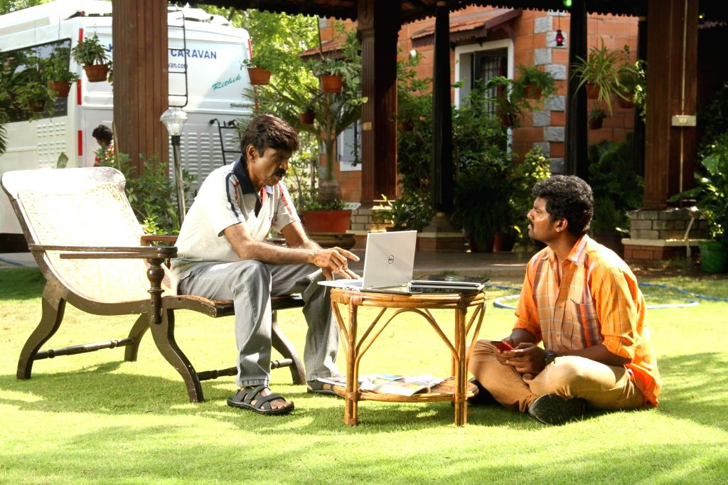 Stills from Tamil film `Enakku Veru Yengum Kilaigal Kidaiyathu`