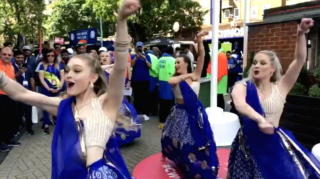 Stills from the latest video which has surfaced on social media where foreigners can be seen dancing on Bollywood tracks. Women in electric blue ghagra-choli are seen doing dandiya on ...
