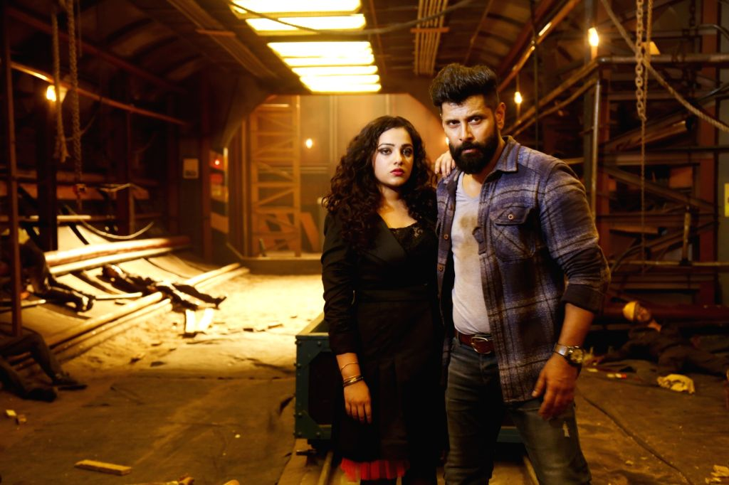 Stills of actor Nithya Menen and Vikram from their upcoming Tamil film 'Iru Mugan'. - Nithya Menen