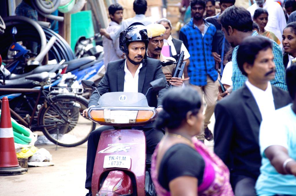 Stills of film Manithan.