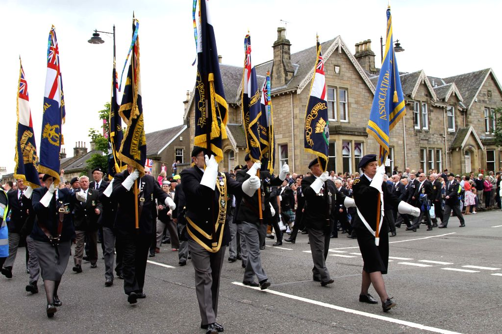 Veterans take part in the celebration of the Armed Forces Day in Stirling, Scotland, Britain, June 28, 2014. Britain's Armed Forces Day was celebrated on Saturday .