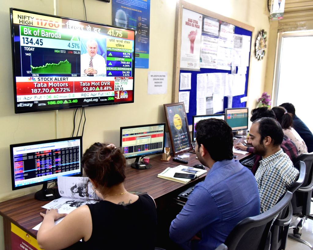 Stock traders monitor share prices in Bikaner, on April 1, 2019. The BSE Sensex on Monday touched a record high and crossed the 39,000 mark for the first time. Around 10.15 a.m., the Sensex ...