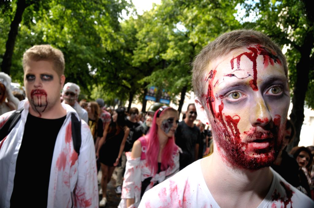 People dressed as zombies take part in a Zombie Walk in Stockholm, Sweden, on Aug.16, 2014.
