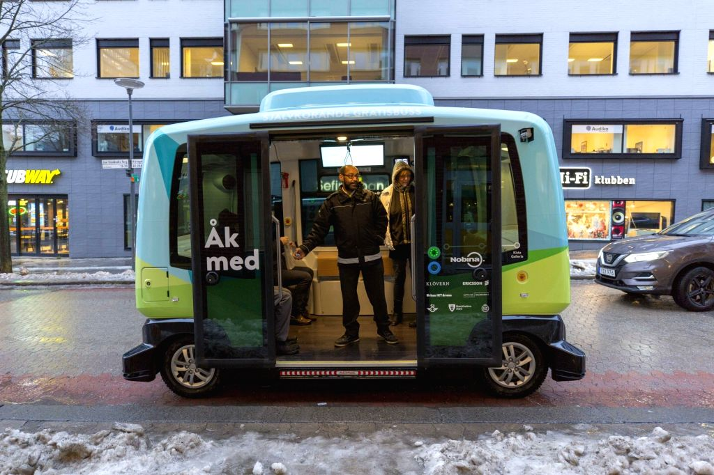 STOCKHOLM, Jan. 24, 2018 - A driverless bus is seen along a 1.5-kilometer road between Kista Mall and Victoria Tower in northern Stockholm, capital of Sweden, on Jan. 24, 2018. The driverless bus, ...