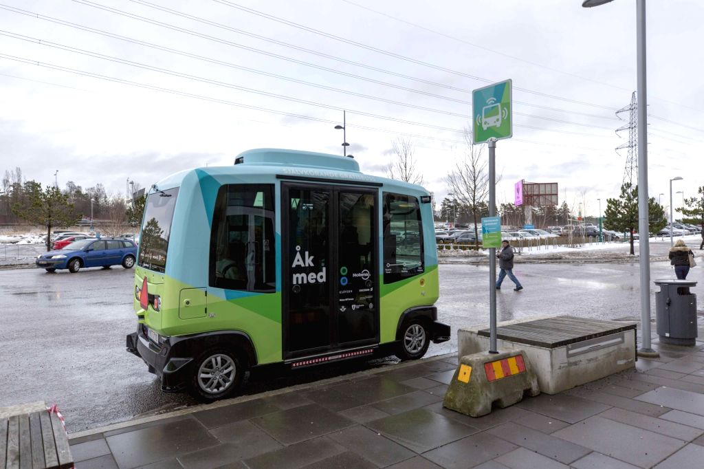 STOCKHOLM, Jan. 24, 2018 - A driverless bus runs along a 1.5-kilometer road between Kista Mall and Victoria Tower in northern Stockholm, capital of Sweden, on Jan. 24, 2018. The driverless bus, the ...
