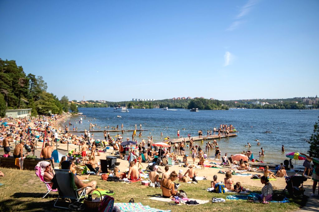 STOCKHOLM, July 27, 2019 - People cool off at a lake beach in Stockholm, capital of Sweden, July 27, 2019. In a new around of heat wave, the highest temperature reached 30 degrees Celcius in ...