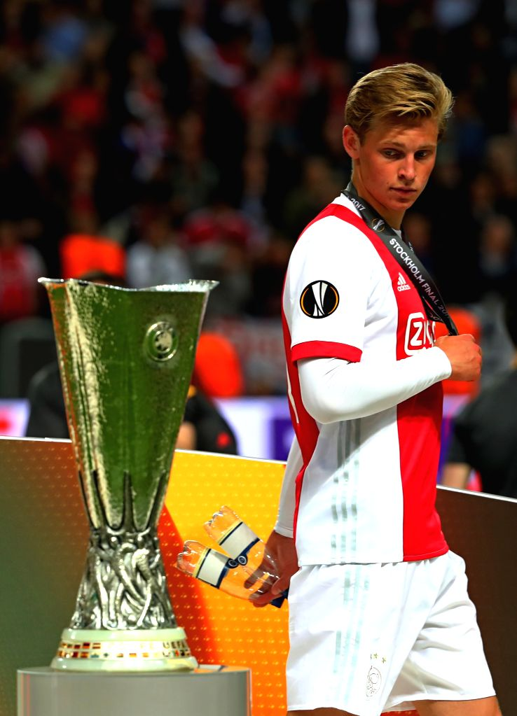 STOCKHOLM, May 25, 2017 - A player of Ajax Amsterdam walks past the trophy after the UEFA Europa League Final match between Manchester United and Ajax Amsterdam at the Friends Arena in Stockholm, ...