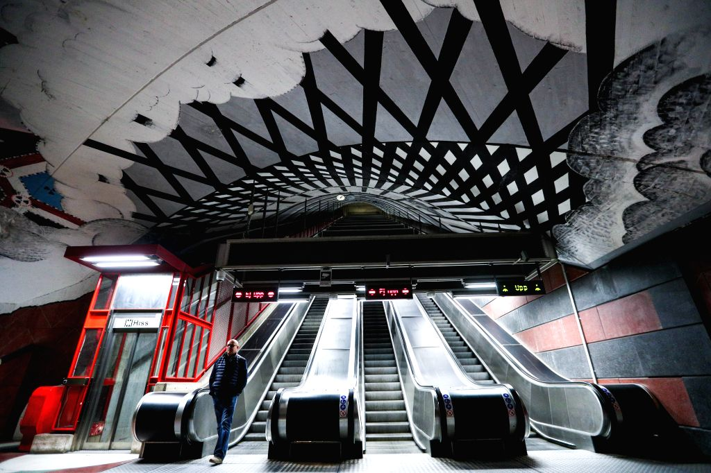 STOCKHOLM, Oct. 10, 2019 - A passenger walks in the Kungstradgard metro station in Stockholm, Sweden, Oct. 8, 2019. Till now, Stockholm's subway system consists of one hundred stations, each with ...