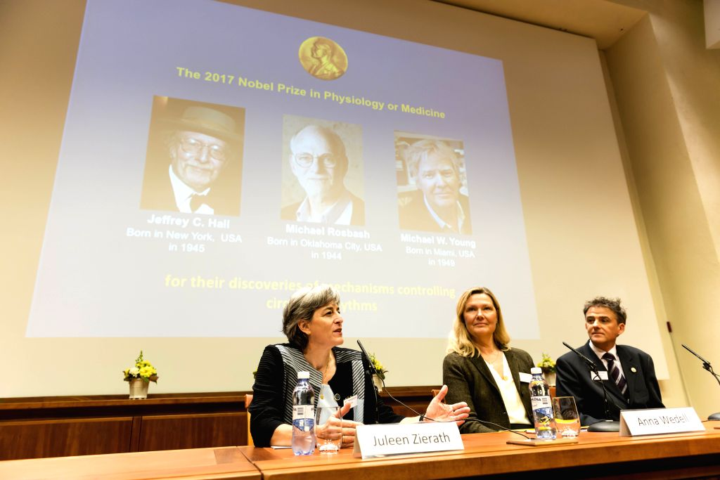 STOCKHOLM, Oct. 2, 2017 - Photos of the three awarded scientists are seen on a screen in Stockholm, Sweden, Oct. 2, 2017. Three scientists share 2017 Nobel Prize in Physiology or Medicine, the Nobel ...