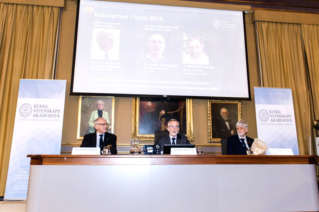 STOCKHOLM, Oct. 4, 2016 - Winners of the 2016 Nobel Prize in Physics are shown on a screen during a press conference at the Royal Academy of Sciences in Stockholm, Sweden, Oct. 4, 2016. The 2016 ...