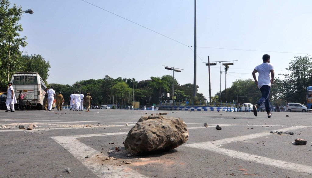 Stones lie on a Kolkata road as protesters alleged to be workers of parties affiliated to the Left Front clash with police after a number of Left Front MLAs including its legislature party ... - Sujan Chakraborty