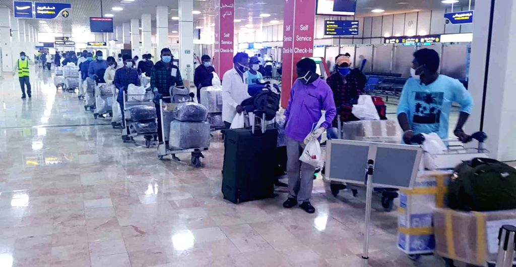 Stranded Indian nationals in Bahrain arrive at Rajiv Gandhi International Airport after they landed in the city via Gulf Air's first flight under the joint initiative of Indian Club ...