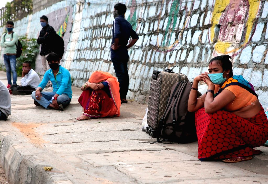 Stranded migrants at Yeshwanthpur railway station during a re-imposed lockdown across Bengaluru till July 22 for containing the corona virus spread, on July 15, 2020.