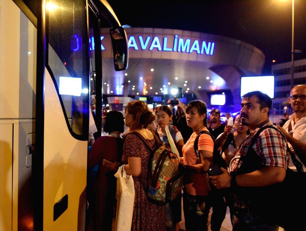 Stranded passengers are transferred to nearby hotels from Ataturk International Airport in Istanbul, Turkey, June 29, 2016. Turkish Prime Minister Binali Yildirim on Wednesday blamed the ... - Binali Yildirim