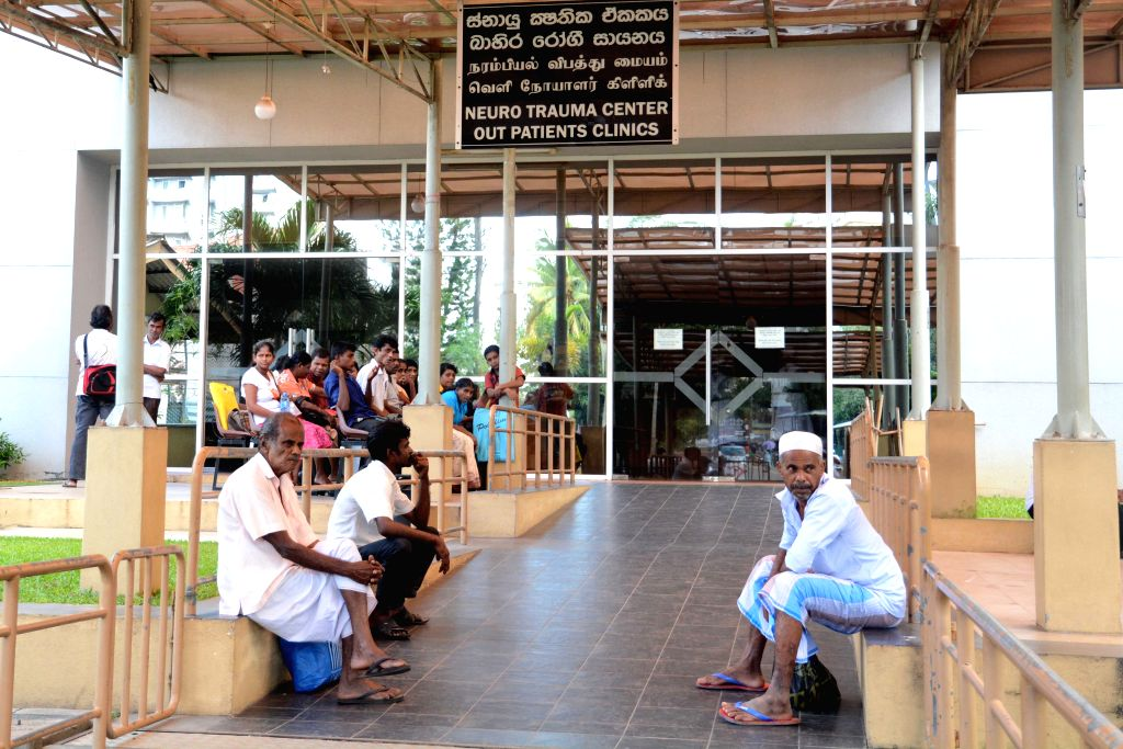 Stranded patients wait in a hospital in Colombo, Sri Lanka, Dec. 3, 2015. Thousands of patients were stranded as several hospitals came to a standstill after all ...