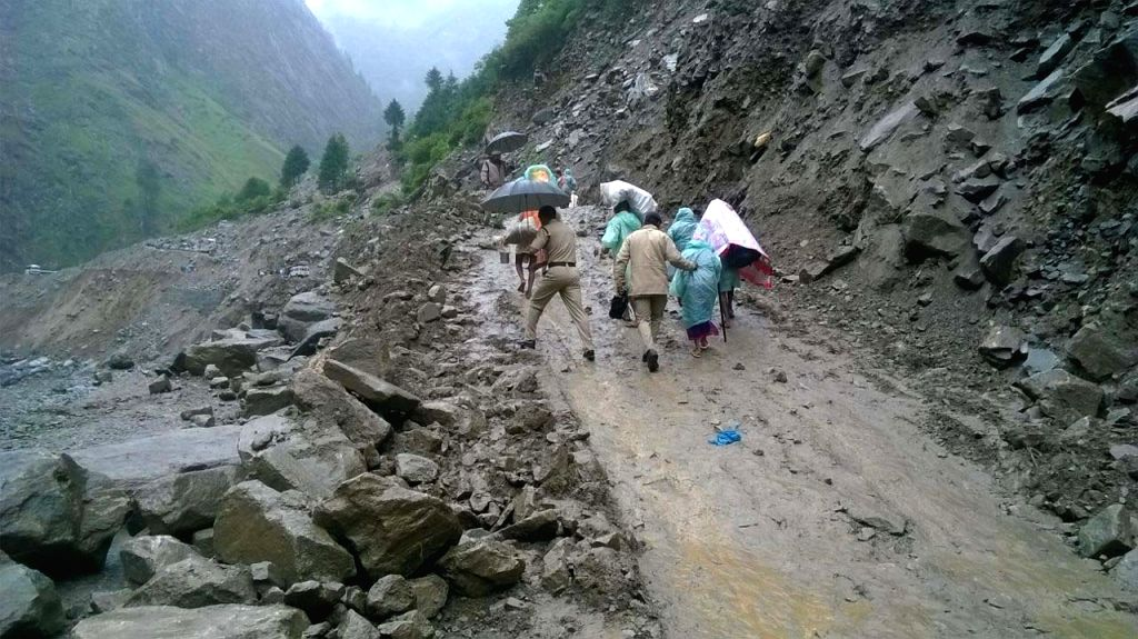 Stranded pilgrims of Hemkunt Saib being rescued by State disaster response force (SDRF) personnel at Chamoli district in Uttarakhand on July 1, 2015.