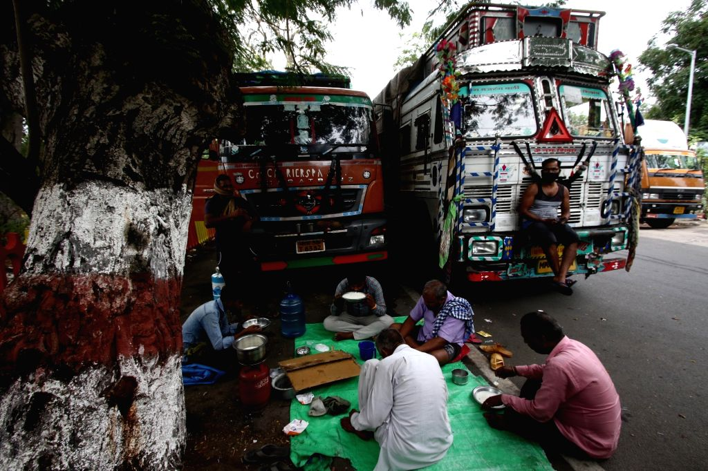 Stranded truckers having food in the midst of their journey during a complete lockdown imposed in Chennai in the wake of COVID-19 pandemic, on July 1, 2020. Tamil Nadu Chief Minister K. ... - K. Palaniswami
