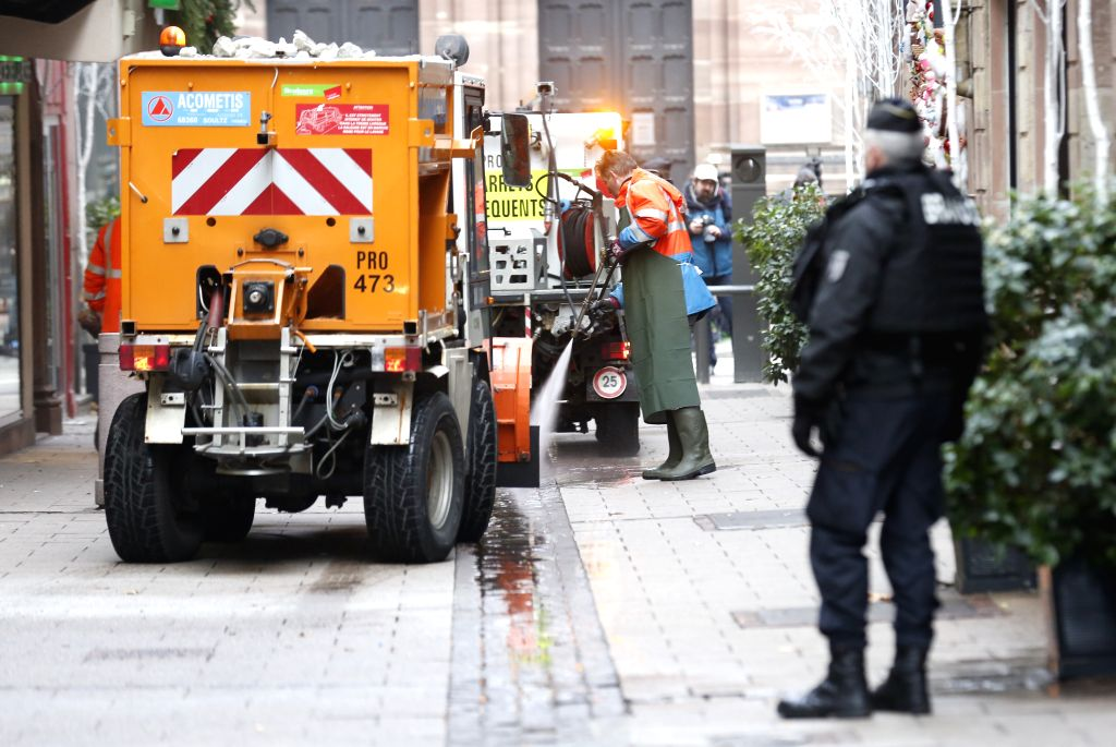 STRASBOURG, Dec. 12, 2018 - Municipal workers clean the site of attack in the center of Strasbourg, France on Dec. 12, 2018. French police are looking for a gunman after he killed at least four ...