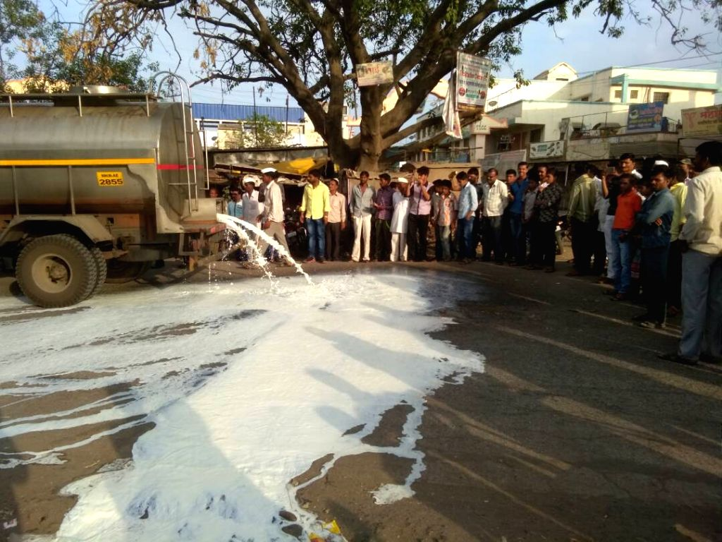 Striking farmers damage a milk tanker on Kolhapur-Mumbai Highway in Maharashtra on June 1, 2017. Over half a million farmers are on 'indefinite strike' in Maharashtra to press for their ...