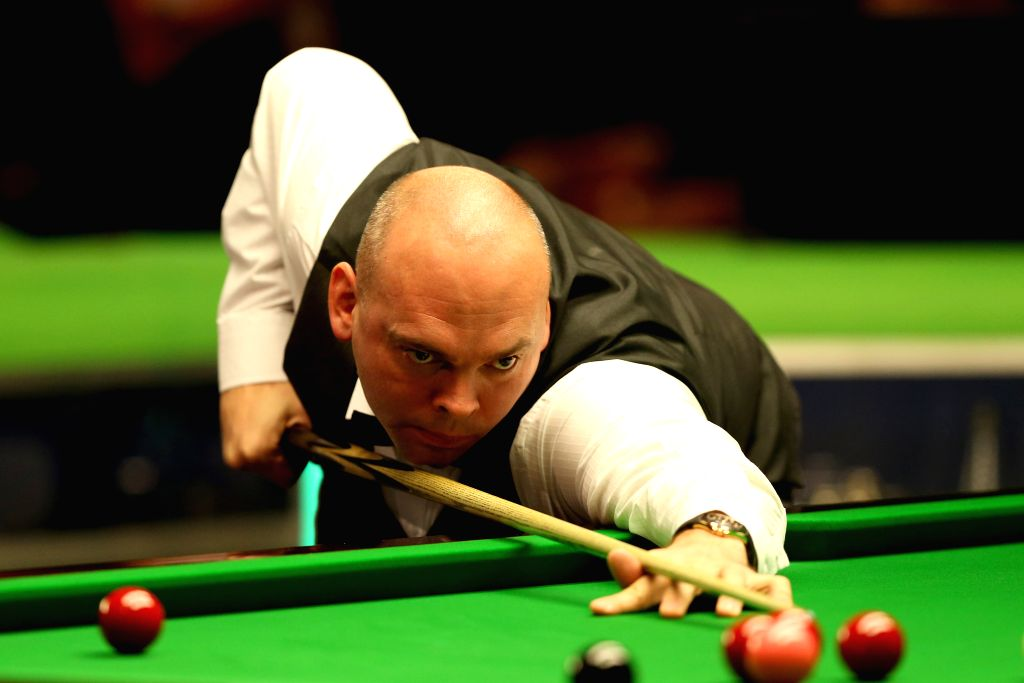 Stuart Bingham of England competes during his second round match against his compatriot Anthony Hamilton at Snooker UK Championship 2015 in York, England on Nov. 28, ...