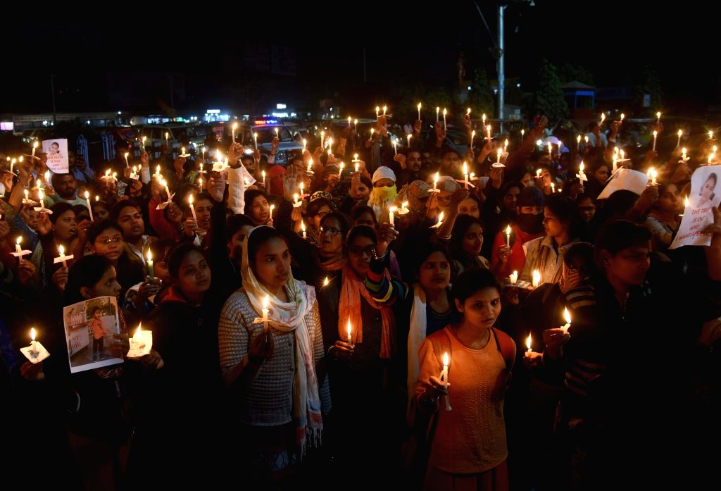 Student of Indira Gandhi Institute of Medical Sciences (IGIMS) take out a candle march protesting over the suicide of a first-year nursing student Khusboo Kumari of (IGIMS), in Patna on Dec 7, ... - Indira Gandhi Institute