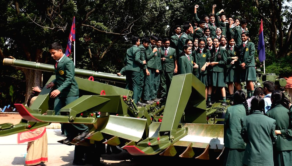 Students aboard a mining plow tank during ceremonial parade of Madras Sappers Regiment at MEG Centre, in Bengaluru on Oct 21, 2016.