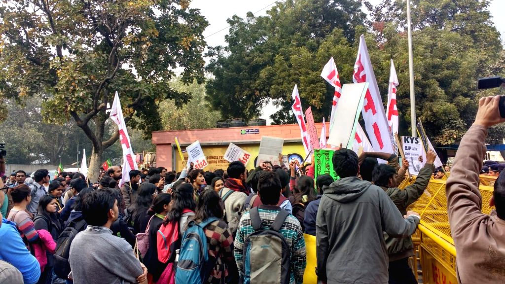 Students affiliated to left wing students organisation stage a demonstrations to press for their demands in New Delhi on Jan 18, 2016.